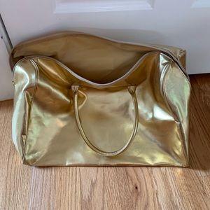 Michael Kors gold zippered tote
